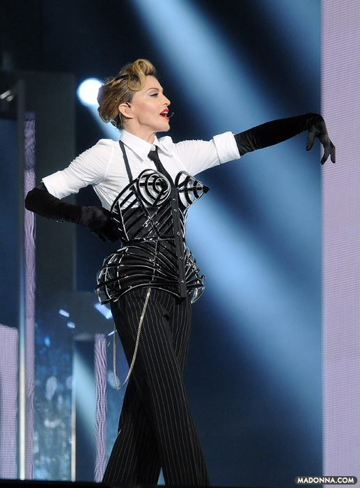 Madonna wearing a Gaultier corset (homage to her 1990 Blonde Ambition Tour) and vogue-ing